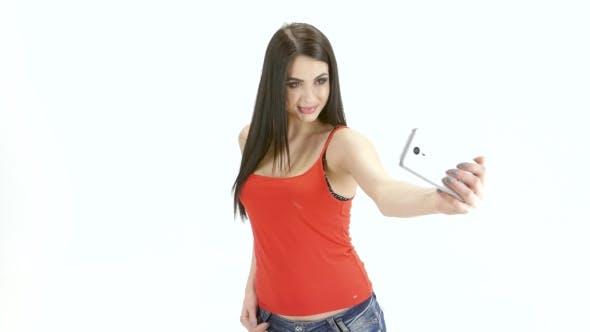 Thumbnail for Brunette Girl Model Makes Selfie Photo on the Mobile. Studio
