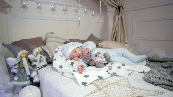 Cute Little Boy, Small Child Sleeps, Baby Lying on the Bed in the Sliders and Cap, Sweet Dream Cute