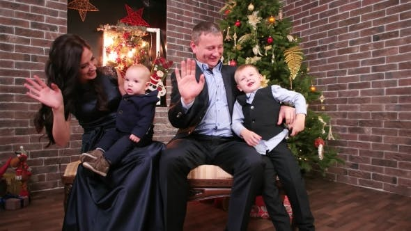 Thumbnail for Portrait of a Family Happy Family, Mother, Father and Sons, Waving His Hand, Looking at the Camera