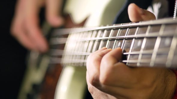 Thumbnail for A Man Plays the Guitar