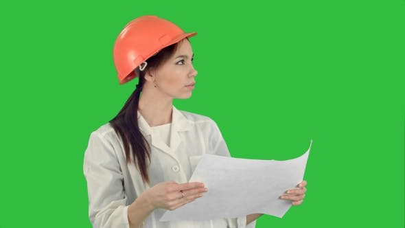 Thumbnail for Young Female Architect Holding Blueprints and Checking Construction
