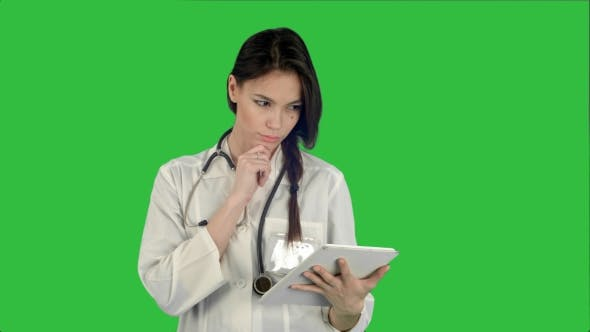 Thumbnail for Pretty Female Doctor with Stethoscope Using Tablet Computer on a Green Screen, Chroma Key