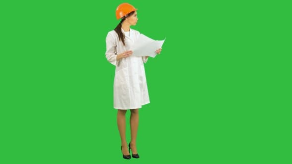 Thumbnail for Young Female Architect Holding Blueprints and Inspecting Construction on a Green Screen, Chroma Key