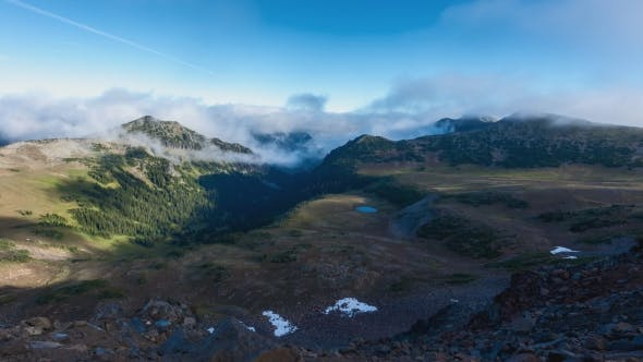 Thumbnail for Clouds Flowing Through a Valley Near Mt. Rainier