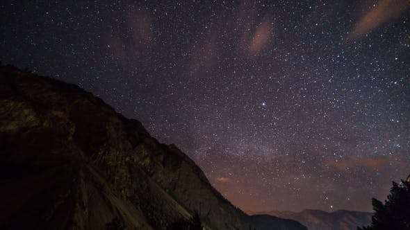 Thumbnail for of Stars Moving Above a Mountain