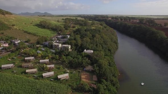 Thumbnail for Flying Over the Town and River on Mauritius Island