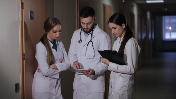 Thumbnail for Doctor with Two Girls Interns Parses the Diagnosis of the Patient