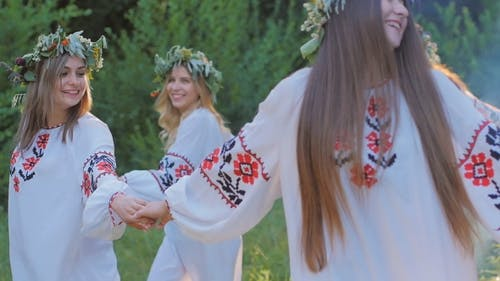 Group of Young People in National Slavic Costumes Dance