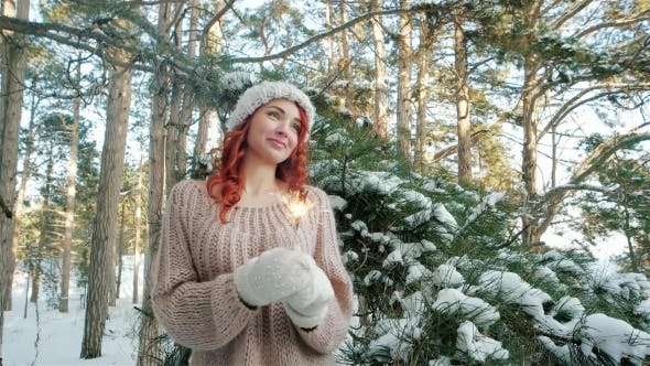 Thumbnail for Girl Holding a Sparkler, Beautiful Girl in the Winter in the Woods, Winter Nature, Winter Fairy Tale