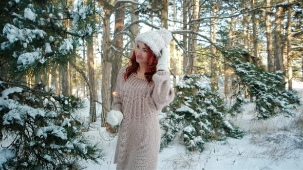 Thumbnail for Winter Fairy Tale, Girl Holding a Sparkler, Beautiful Girl in the Winter in the Woods, Winter Nature