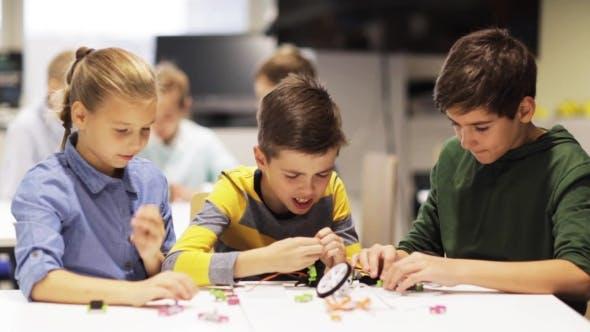 Thumbnail for Happy Children Making High Five at Robotics School 52