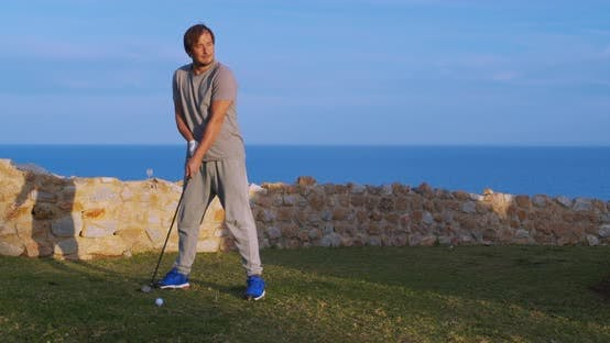 Thumbnail for Man Golfer in Sunset Enjoying Vacation on Luxury Resort
