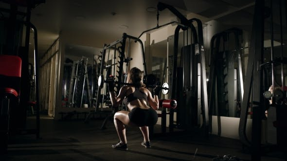 Thumbnail for Girl Doing Squatting with Barbell in the Gym