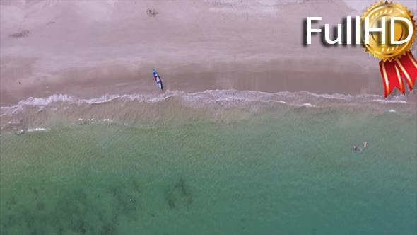 Aerial View of the Clean Sandy Beach With Jet Ski