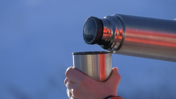 Pouring Tea From a Thermos