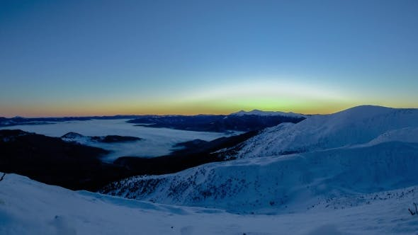 Brilliant Summit Dawn Above Flowing Cloud Waves, Red Sun Disk