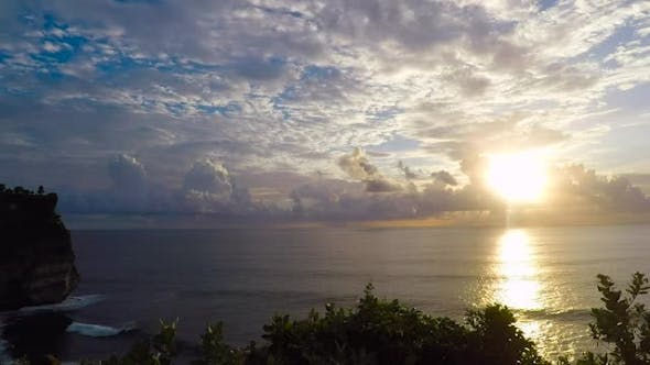 Thumbnail for Incredibly Beautiful View of the Sunset on the Ocean. A Lot of White Clouds and Sea Waves. The Water