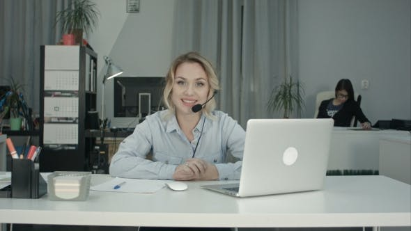 Thumbnail for Smiling Female Consultant with Headset Presenting Company Services