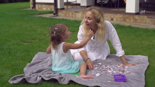 Thumbnail for Mom Playing with Little Blonde Girl