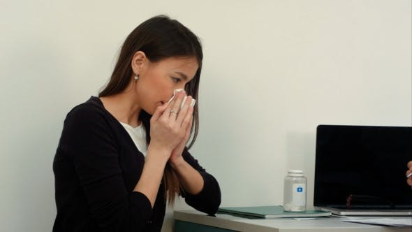 Cover Image for Sneezing Sick Female Patient Complaining To the Doctor