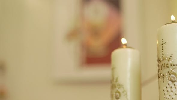Cover Image for Mother of God Against Candles in Church.