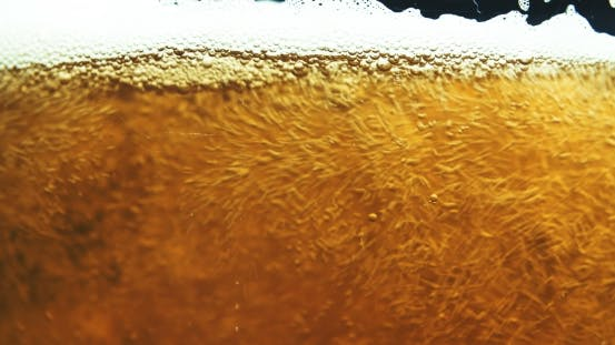 Thumbnail for Glass Full of Beer Slow Moving Bubbles