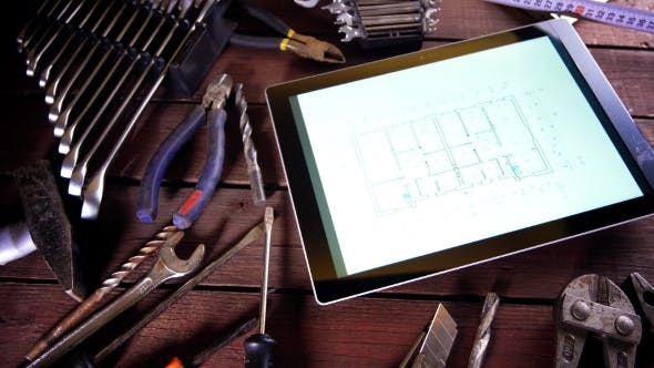 Thumbnail for Many Old Rusty Tools and Modern Tablet on Desk