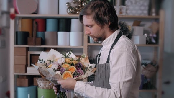 Thumbnail for Happy Smiling Florist Man Making Bunch at Flower Shop. People, Business, Sale and Floristry Concept