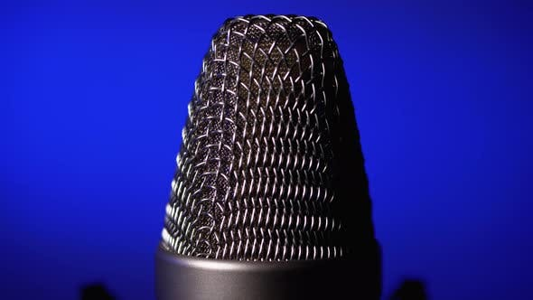 Thumbnail for Studio Condenser Microphone Rotates on Blue Background