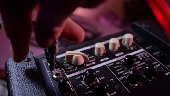 Thumbnail for Man's Hand Removes the Cable Jack From Guitar Amp