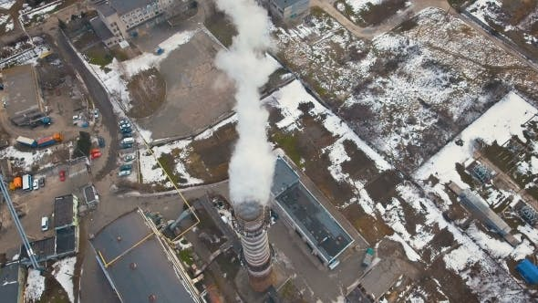 Thumbnail for Top of the Pipe with Steam During the Winter Heating Season (Aerial Shot). . Pipes of a Thermal