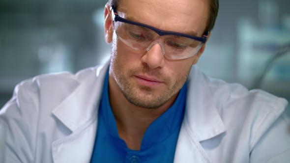 Thumbnail for Scientist Face. Portrait of Researcher Working in Safety Glasses
