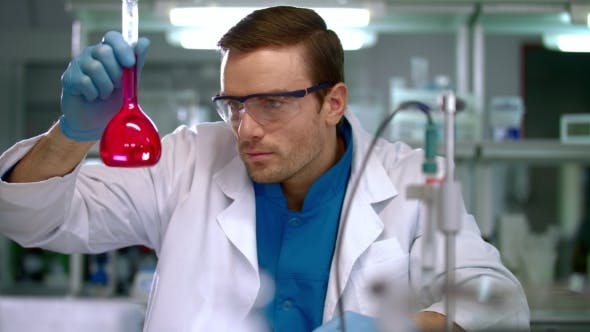 Thumbnail for Scientist Checking Test Tube with Pink Liquid. Laboratory Researcher
