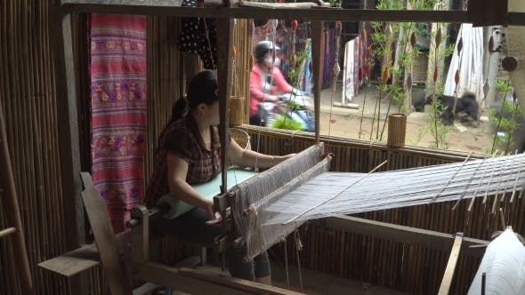 Thumbnail for Woman Working with a Waist Loom