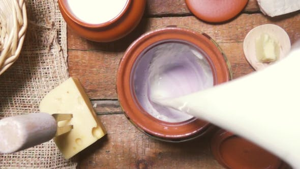 Thumbnail for Milk Being Poured Into an Earthenware Pot Top View