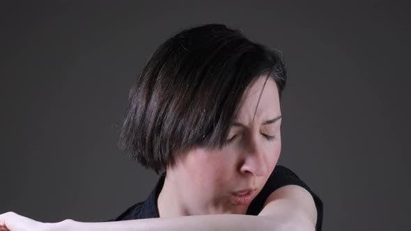 Thumbnail for Portrait of a Caucasian woman coughing painfully, coronavirus symptoms
