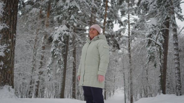Thumbnail for Elderly Woman in the Middle of Snow-covered Forest
