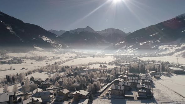 Thumbnail for Flying Over the Snow-covered Austrian Village