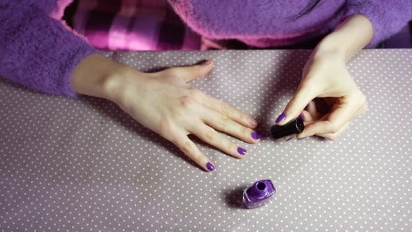 Thumbnail for Young Woman Paints Her Nails with Violet Varnish