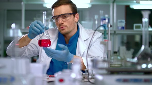 Thumbnail for Scientist in Lab. Scientist Looking at Chemical Liquid in Research Laboratory