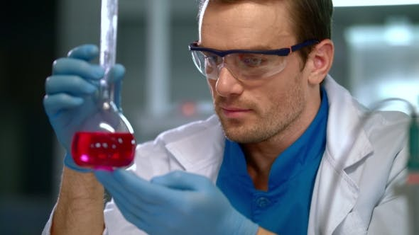Thumbnail for Scientist Doing Laboratory Research. Scientist Face at Research Lab