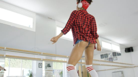 Thumbnail for Low Angle View of Female Dance Student in Shorts