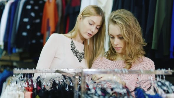 Thumbnail for Two Young Caucasian Women Choose Things in Women's Clothing Store