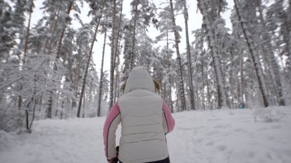 Thumbnail for Back View of Energetic Woman in White Waistcoat and Black Trousers Doing Active Nordic in the Forest