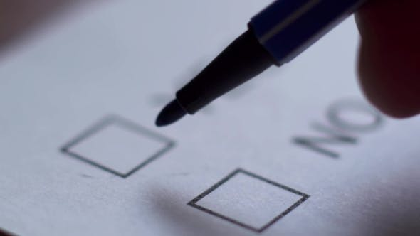 Thumbnail for Cropped of Businesswoman Writing on Checklist