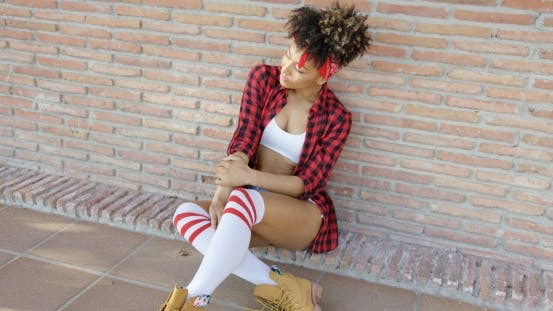 Thumbnail for Fashionable Sexy Girl Sitting on Urban Street