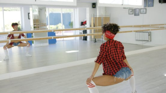 Thumbnail for Female Dancer Practices Her Moves in Studio