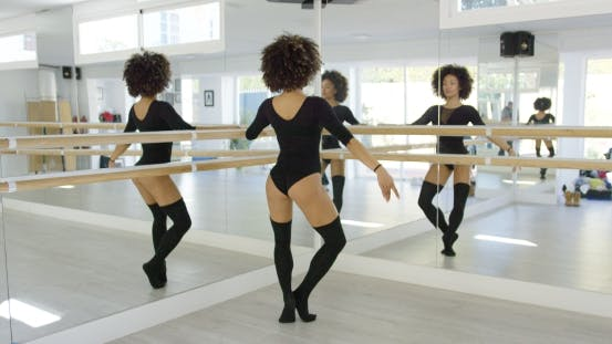 Multiple Reflections of a Young Dancer