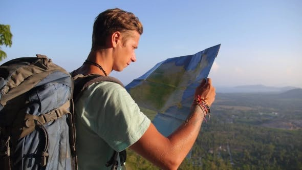 Thumbnail for Traveller Man with Map and Backpack Exploring Country on Trekking Adventure