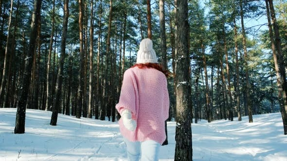 Thumbnail for Cute Girl Walking in Winter Forest, a Woman with Red Hair, Running Around in the Snow